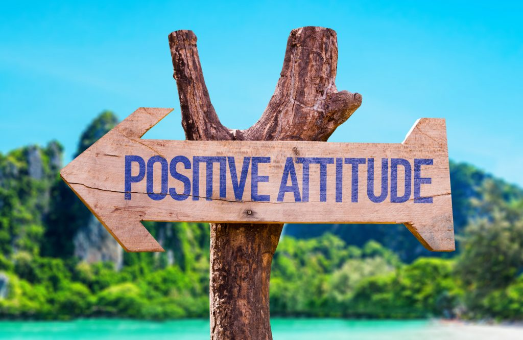 Positive Attitude arrow with beach background